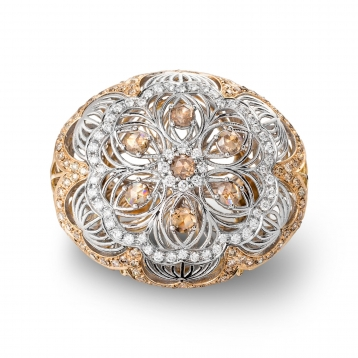 Ring in rose gold, white gold and diamonds